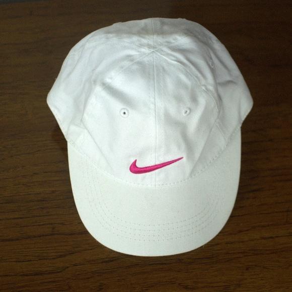 888200c9a9dd9 NWOT Nike KIds  White Ball Cap w  Pink Swoosh. M 5c005a6b7386bc68de928e72.  Other Accessories ...